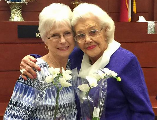 Mary Smith, 76, left, celebrates her adoption by 92-year-old Muriel Clayton on Tuesday, June 9, 2015, in Dallas. Biologically cousins, their lives have been intertwined since Smith was 11. (Photo: Marie Saavedra, WFAA-TV, Dallas-Fort-Worth)
